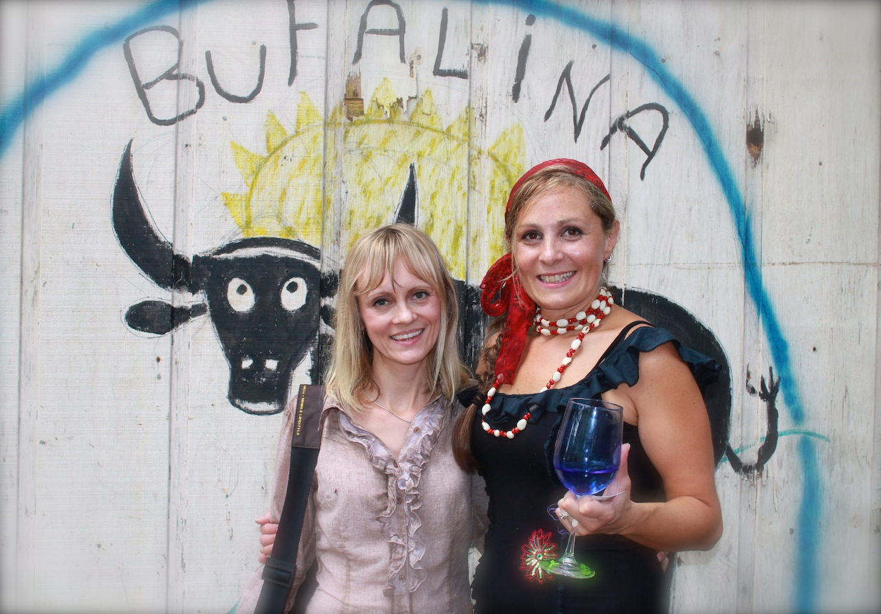 I am with Antonio's wife at the background of their cute logo 'Bufalina'.