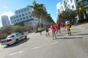 Skaters move along the roads escorted by the Miami Police.