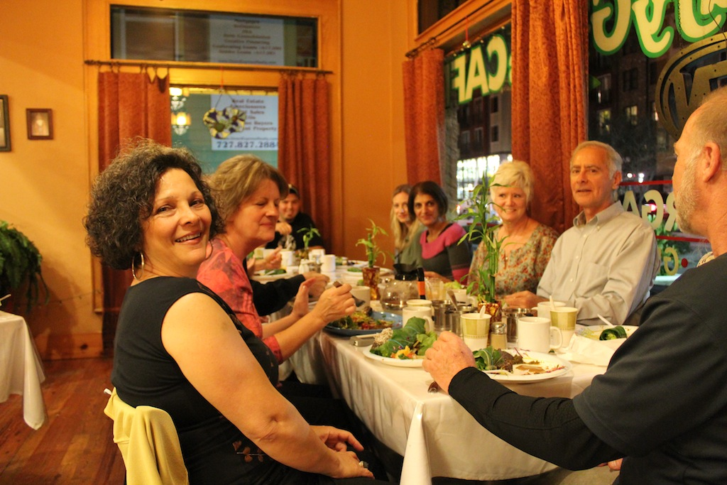 Denise, a cafe owner and a host of Raw Food Meetup in St Petersburg, FL with other members enjoying delicious raw meals.